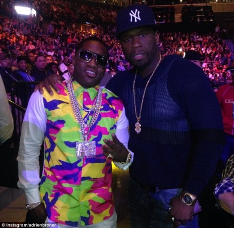 2790E6A300000578-0-Adrien_Broner_sports_a_bright_shirt_and_bling_with_his_own_initi-a-109_1429024127419